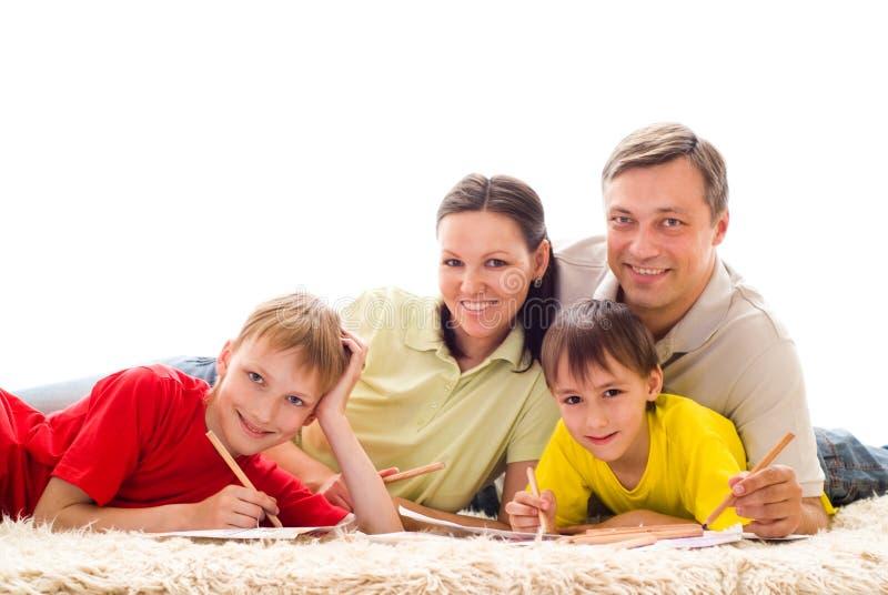 Happy family four stock photos