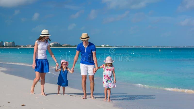 Happy family of four on caribbean holiday vacation stock photo