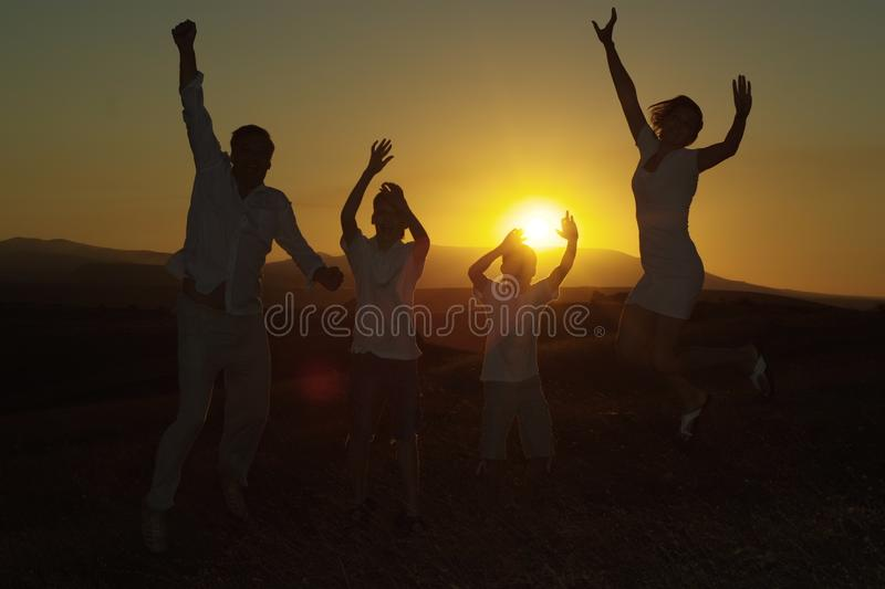 Happy family of four royalty free stock images