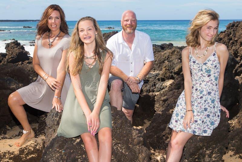 Happy Family together at the beach. Happy family of four on a Hawaiian vacation stock photo