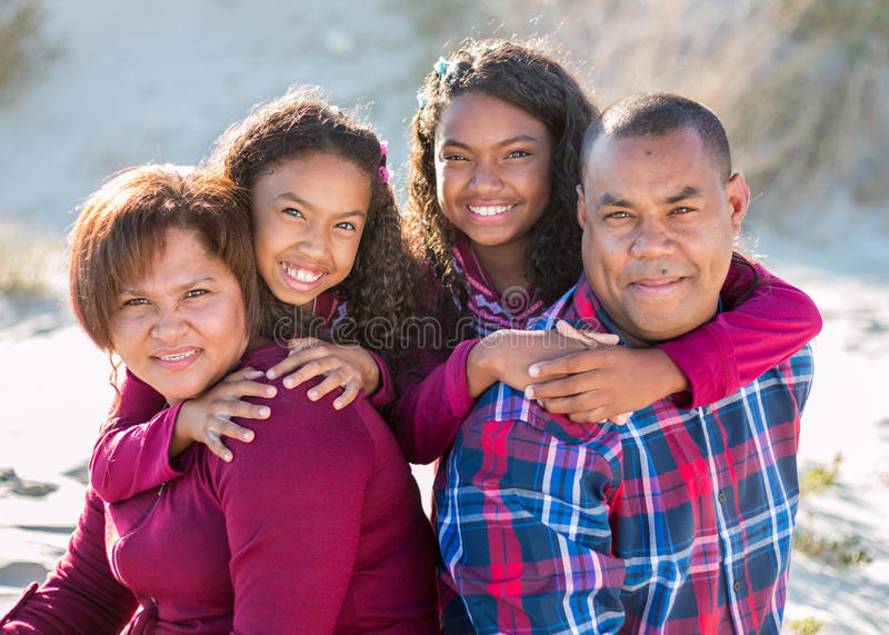 Happy family of four outdoors casual close-up portrait royalty free stock images
