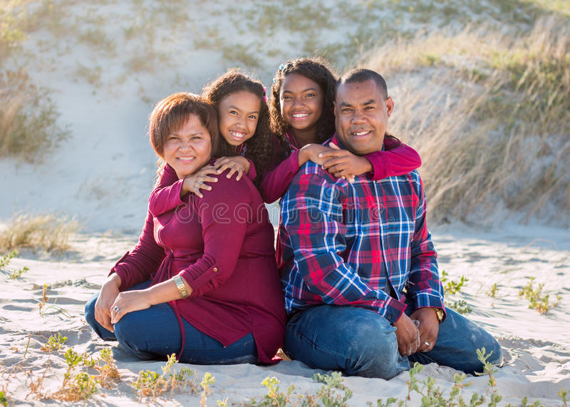 Happy family of four outdoors casual portrait royalty free stock photography