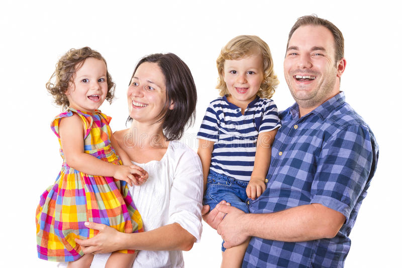 Happy family of four smiling stock photography