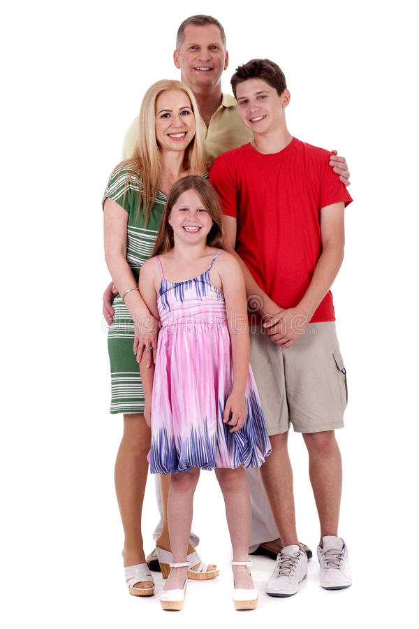 Happy family of four standing and looking at you royalty free stock photo