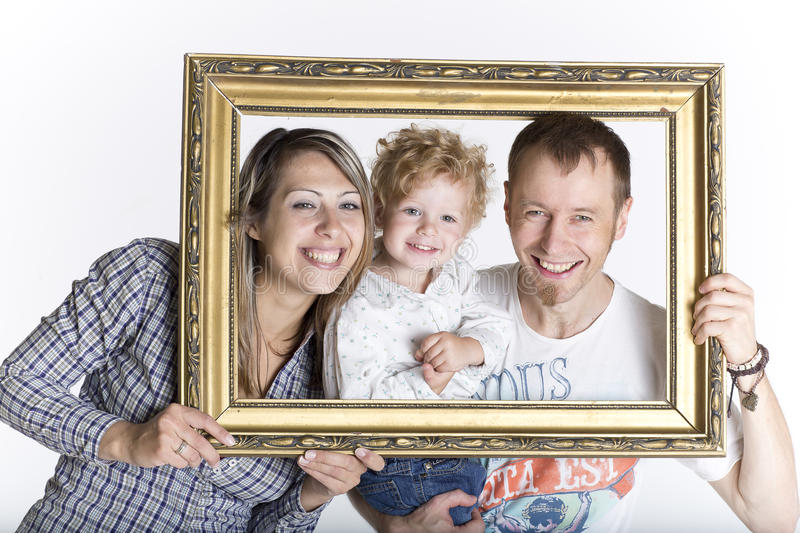 Happy family framed by a picture frame stock photography