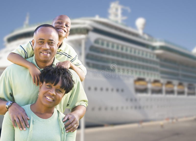 Happy Family in Front of Cruise Ship stock images