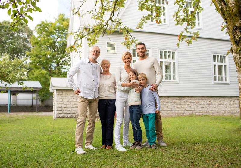 Happy family in front of house outdoors royalty free stock photography