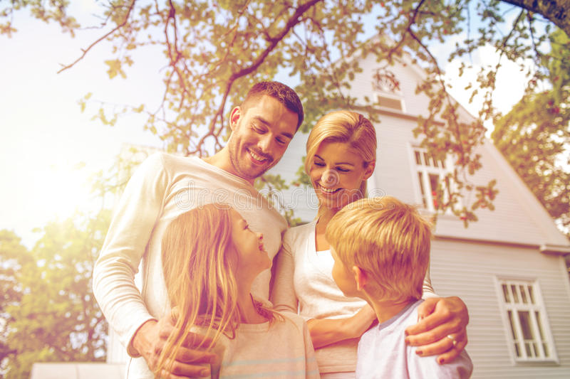 Happy family in front of house outdoors royalty free stock image