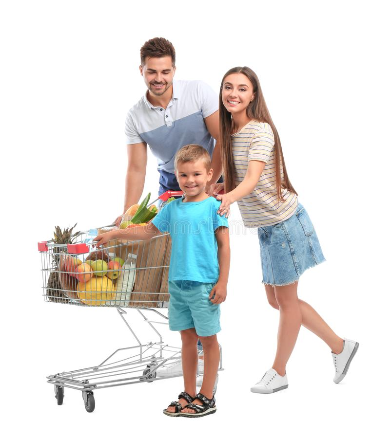 Happy family with full shopping cart on background. Happy family with full shopping cart on white background stock photos