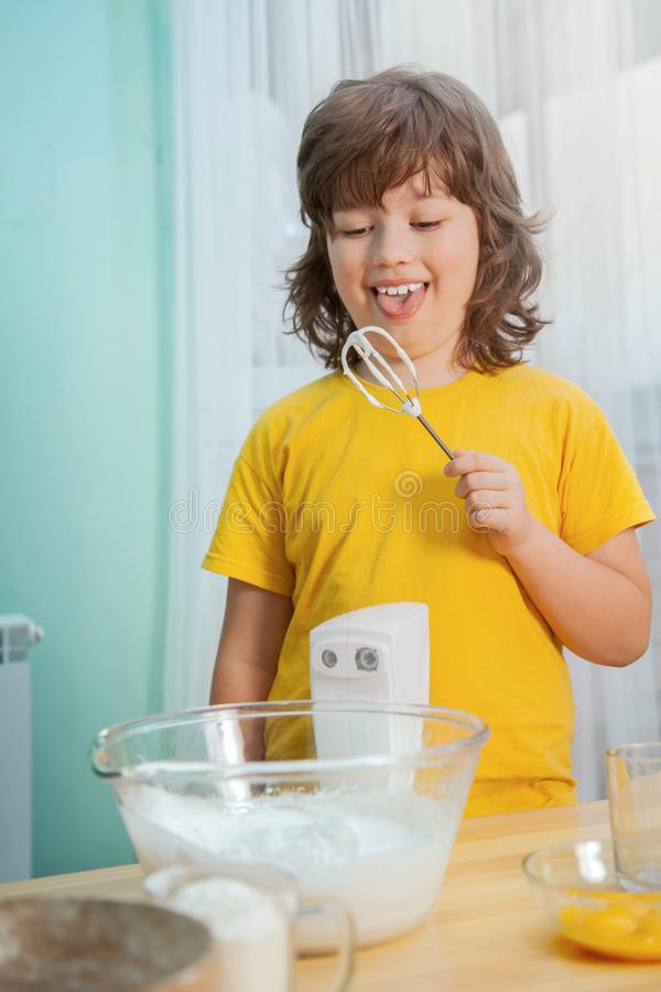 Happy family funny kids are preparing the dough, bake cookies in. The kitchen stock photos