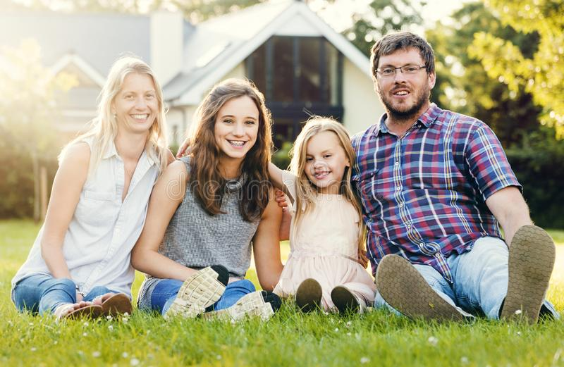 Happy family in the garden stock images