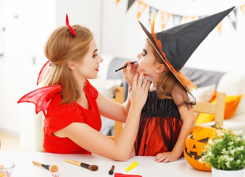 Happy family getting ready for halloween make make-up royalty free stock images