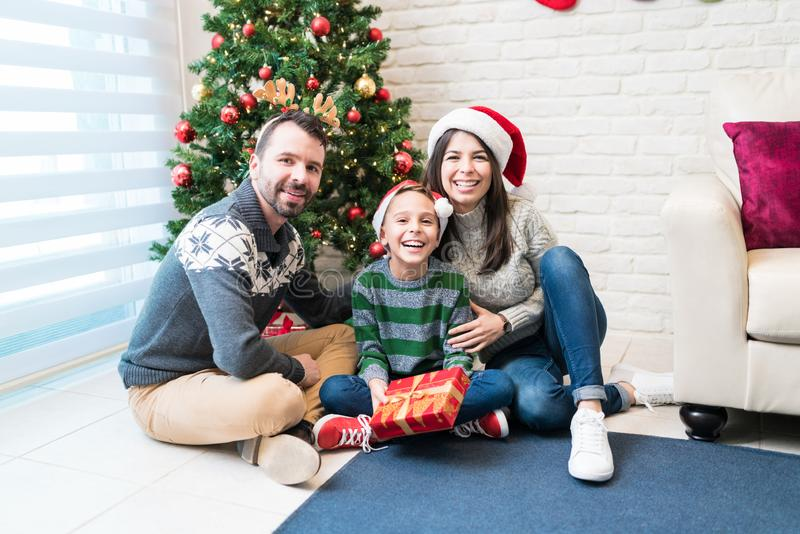 Happy Family With Gift Against Xmas Tree At Home stock photography