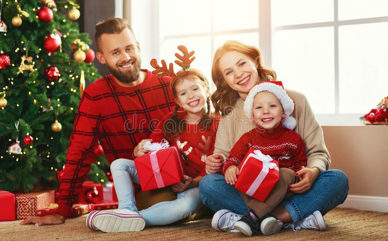 Happy family with gifts near   Christmas tree at home royalty free stock photo