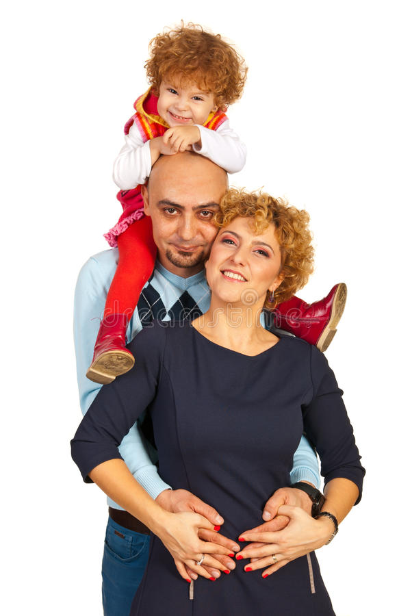 Happy family giving piggy back to their girl royalty free stock photos