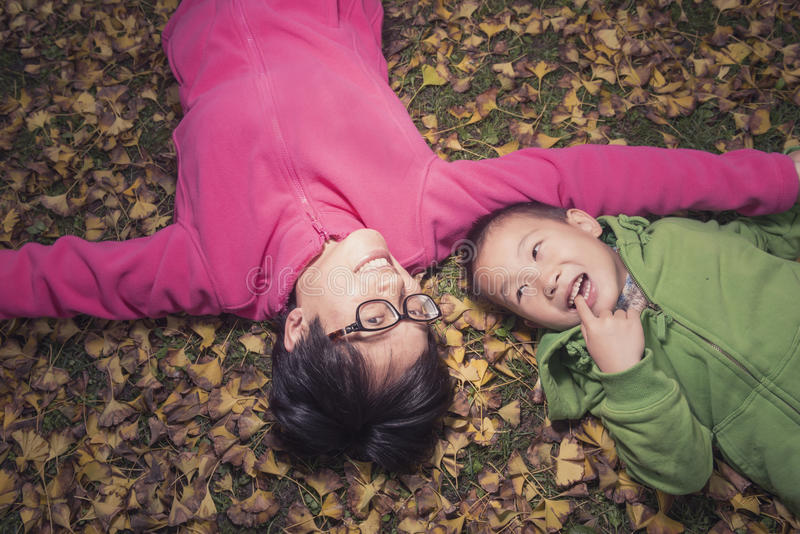 Happy family on golden leaves background royalty free stock image