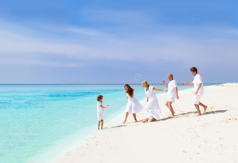 Happy family with grandparents playing on beach royalty free stock photo