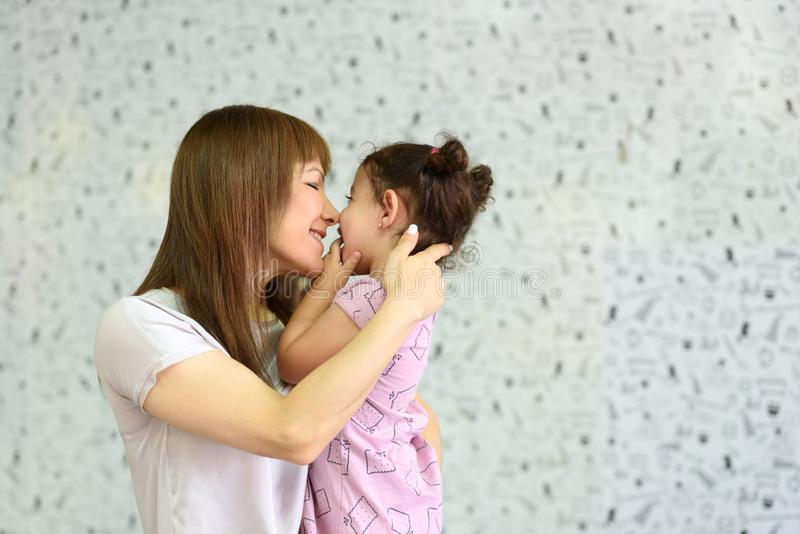 Liitle child spend time with young grandma. royalty free stock images