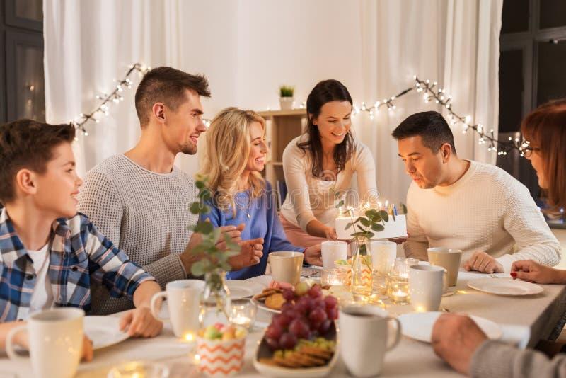 Happy family having birthday party at home royalty free stock image