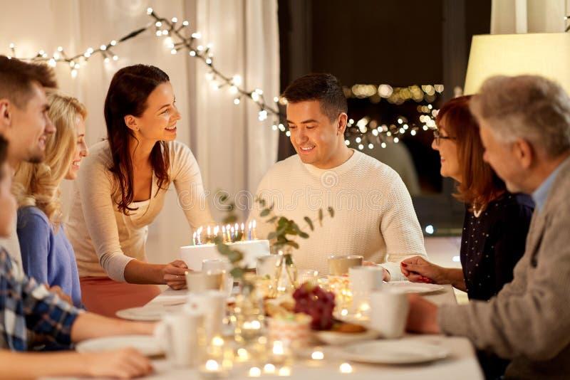 Happy family having birthday party at home stock photo