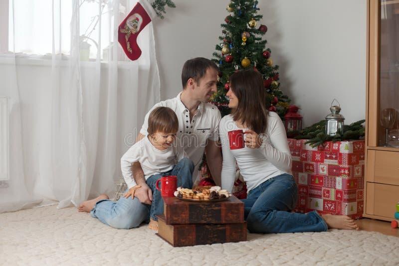 Happy family having breakfast on Christmas stock photos