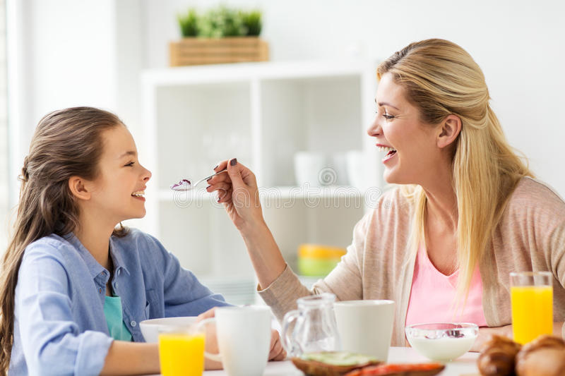 Happy family having breakfast at home kitchen royalty free stock images