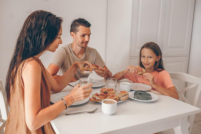 Happy family having breakfast together in kitchen royalty free stock image