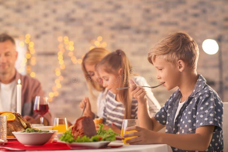 Happy family having Christmas dinner at home royalty free stock photo