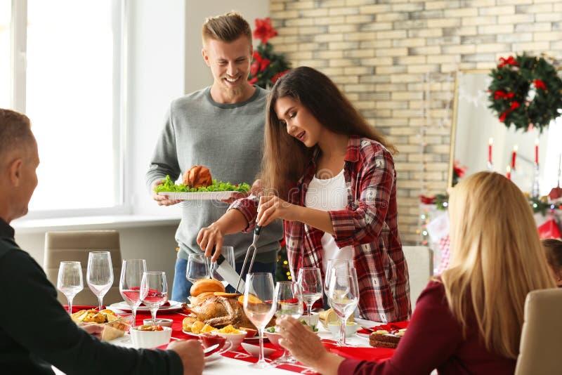 Happy family having Christmas dinner at home royalty free stock photos
