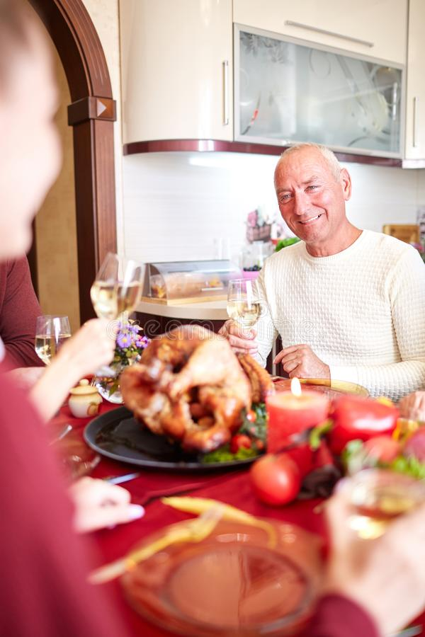 Happy family having holiday dinner at home. Food concept. stock photos