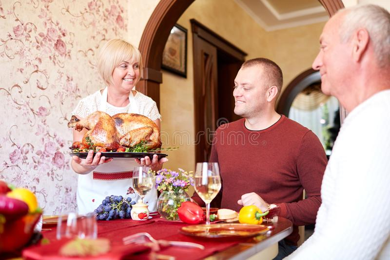 Happy family having holiday dinner at home. Food concept. stock photo