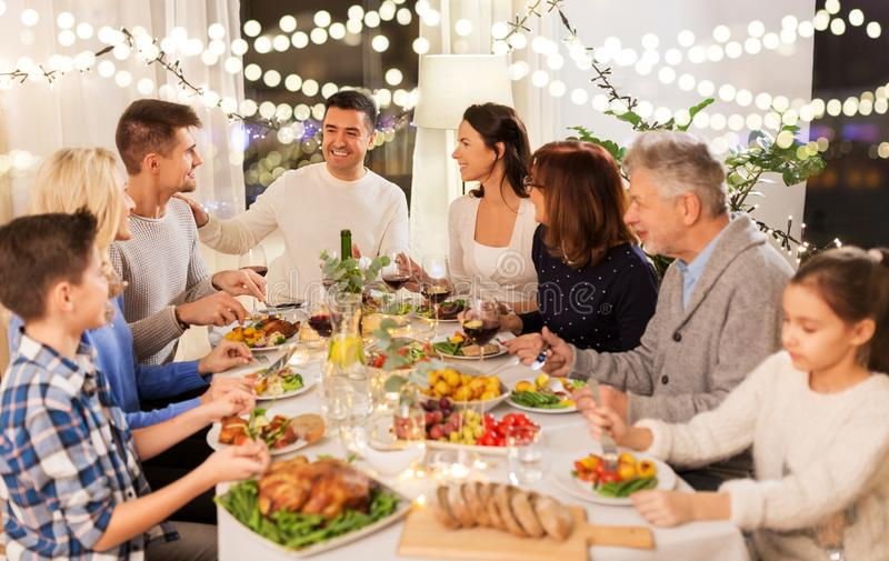 Happy family having dinner party at home royalty free stock images