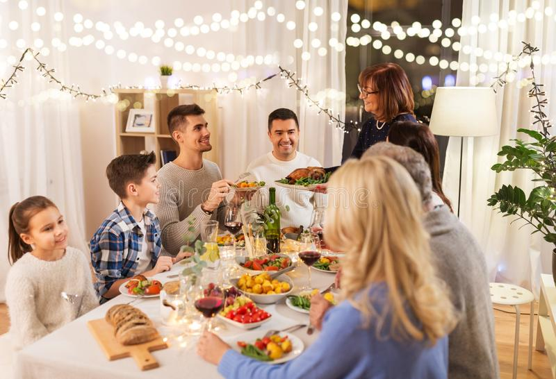 Happy family having dinner party at home royalty free stock photography