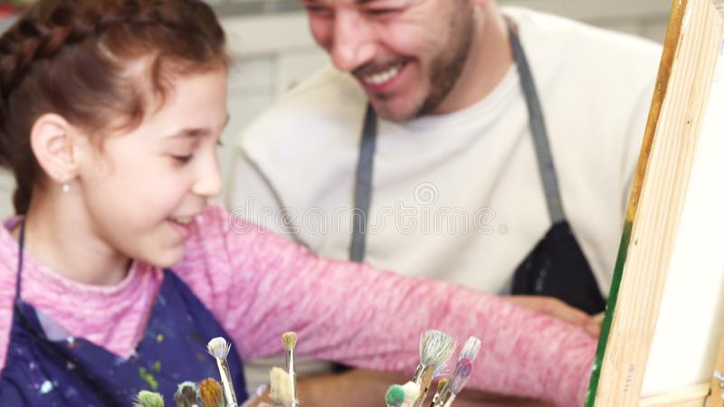 Happy family having fun drawing at the art studio together royalty free stock images