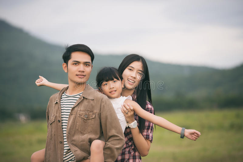 Happy family having fun and enjoying journey in the park at the. Sunset time royalty free stock photo