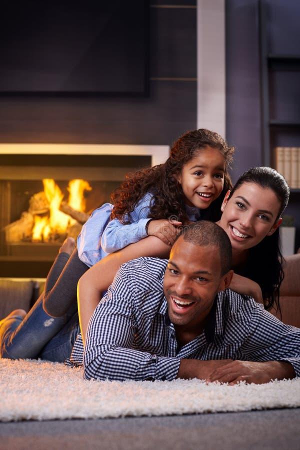 Happy family having fun at home stock photography