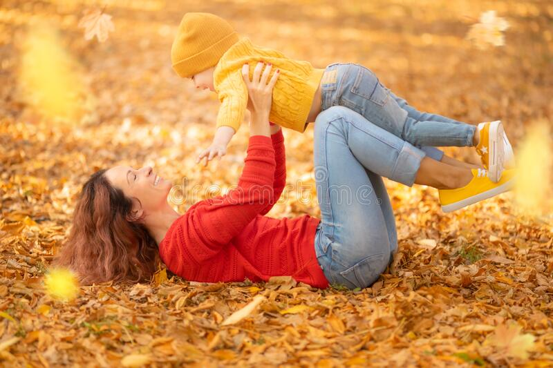 Happy family having fun outdoor in autumn park stock image