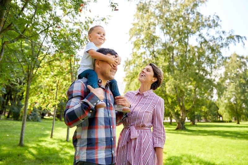 Happy family having fun at summer park royalty free stock images