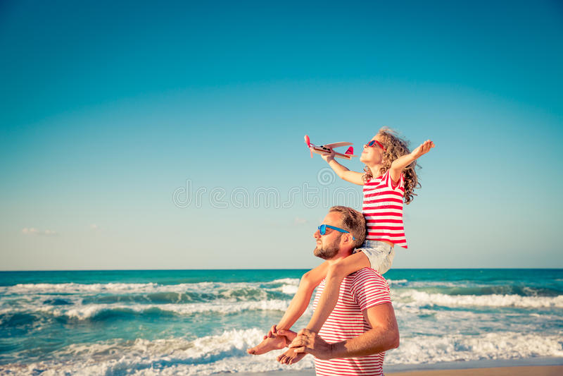 Happy family having fun on summer vacation royalty free stock photography