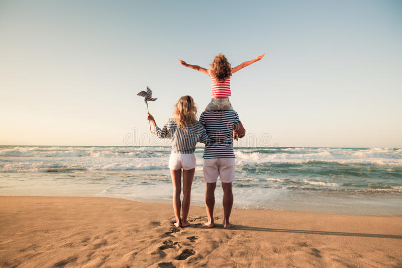 Happy family having fun on summer vacation stock image