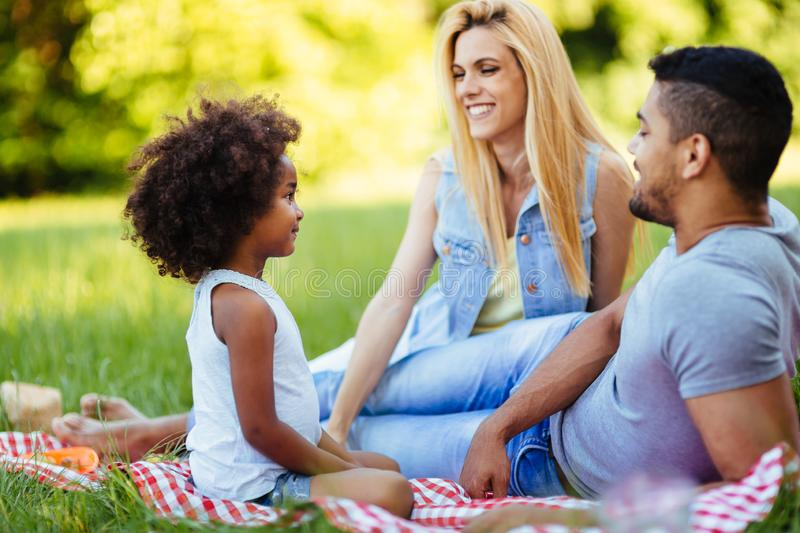 Happy family having fun time on picnic royalty free stock photo