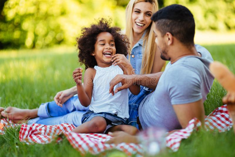 Happy family having fun time on picnic stock photo