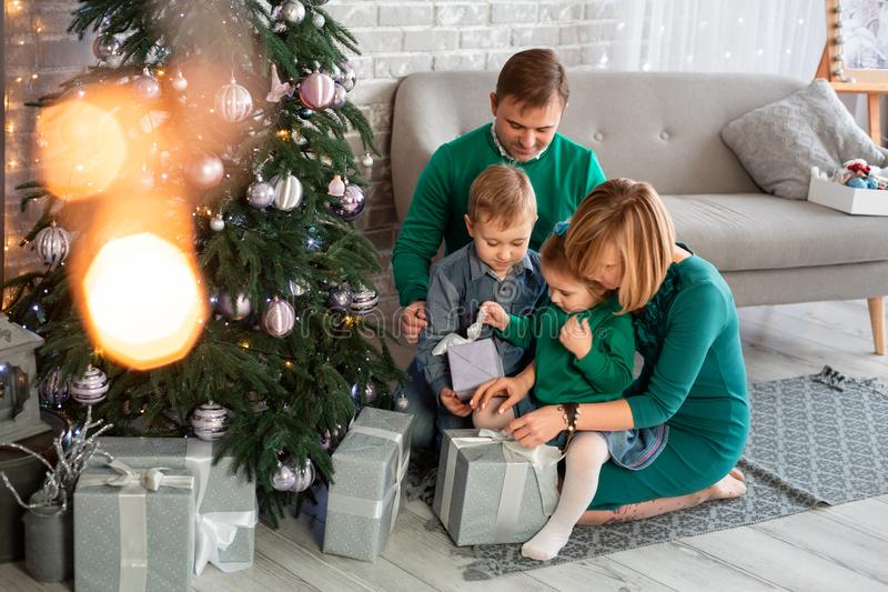 Happy family having fun together near Christmas tree. At home stock photos