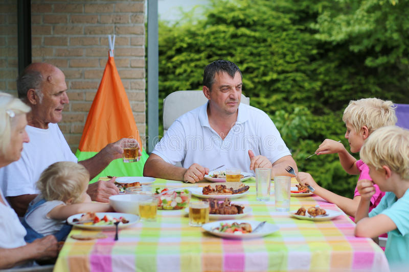 Happy family having meal together stock photos