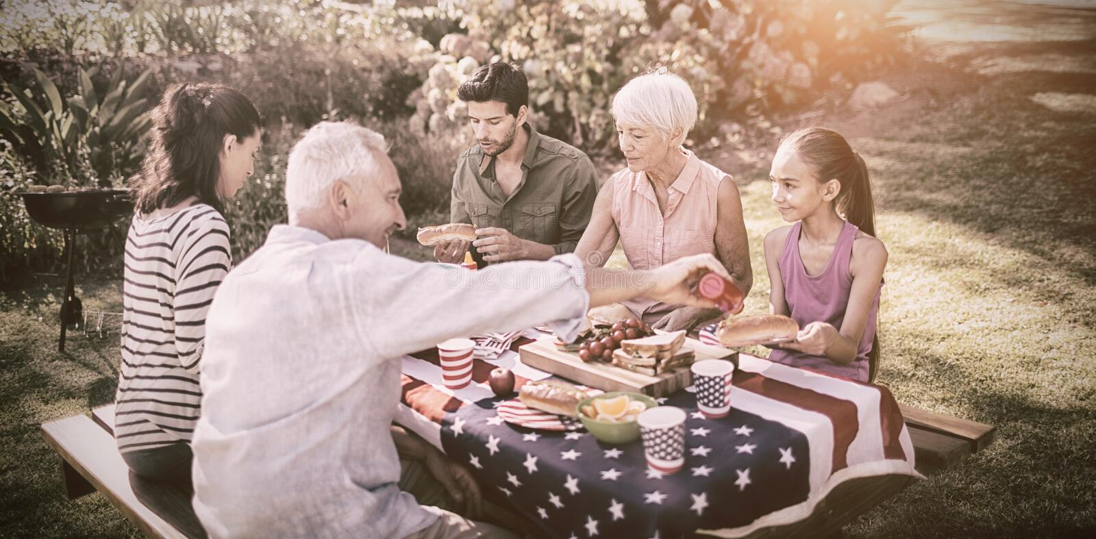 Happy family having a picnic. On an american tableclothe royalty free stock photo