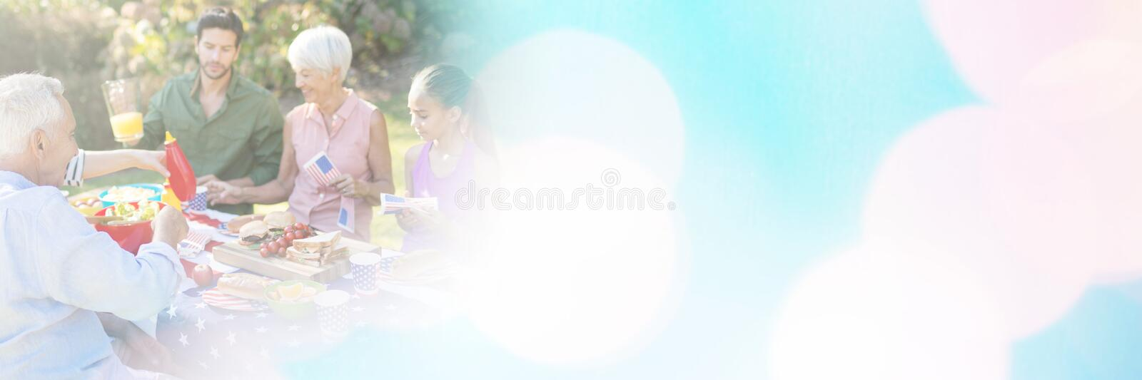 Happy family having a picnic. On an american tableclothe royalty free stock photos