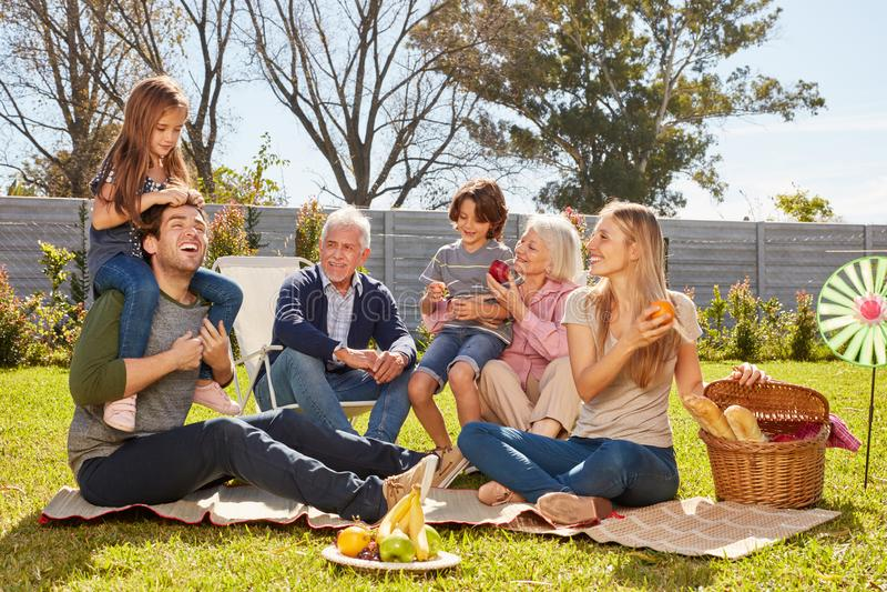 Happy family is having a picnic in the garden stock photos