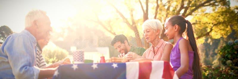 Happy family having a picnic. On an american tableclothe stock photos