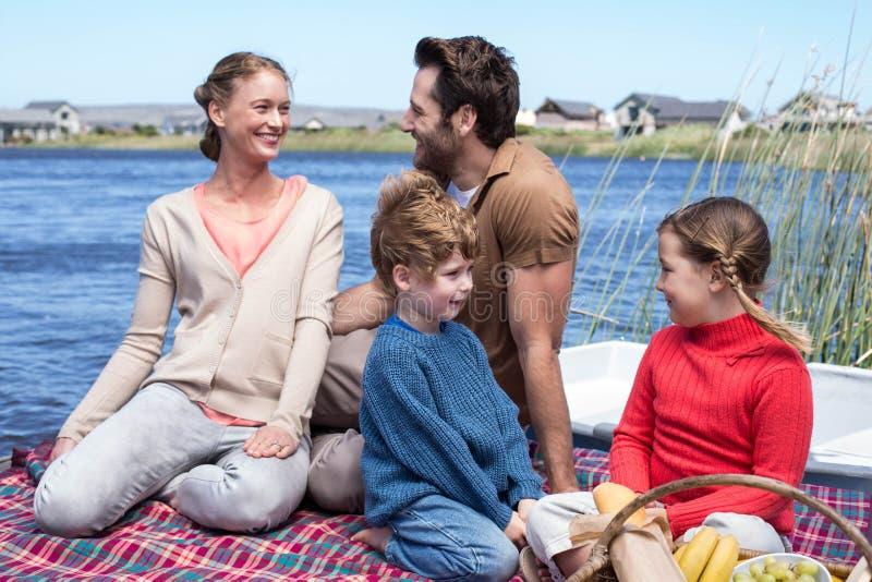 Happy family having picnic at a lake stock photography