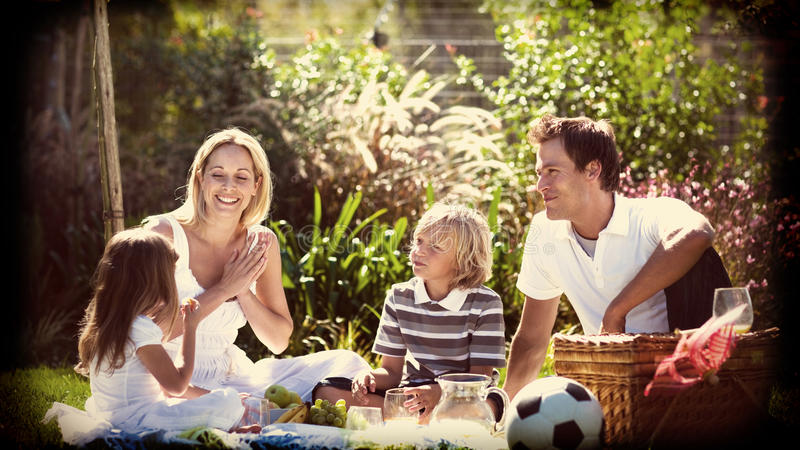 Happy family having a picnic stock illustration